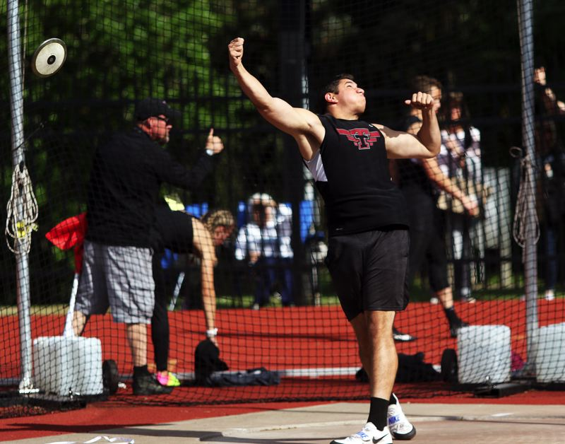 PMG FILE PHOTO: DAN BROOD - Tualatin High School senior Nano Kis is the defending Class 6A state champion in the discus event.