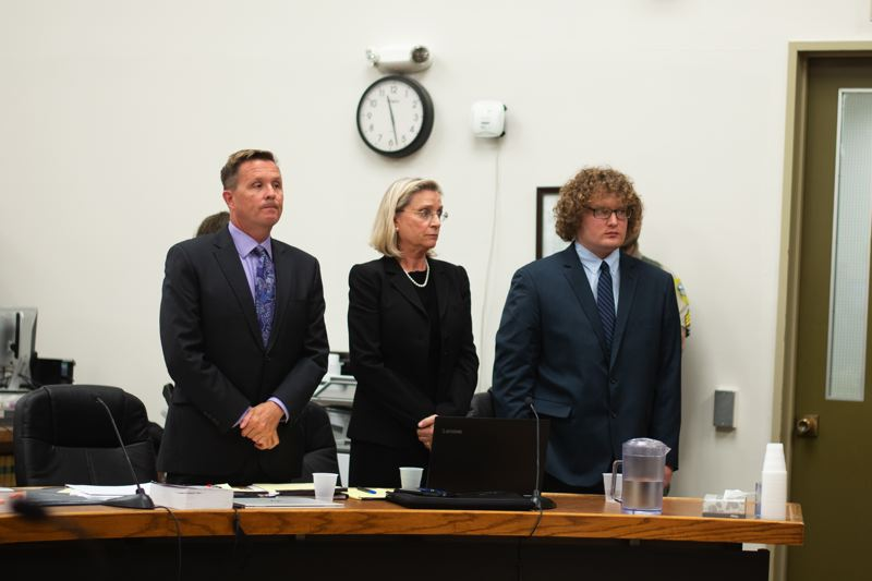 PMG PHOTO: ANNA DEL SAVIO - Daniel Butts, right, stands with his attorneys before sentencing on Tuesday, March 26.