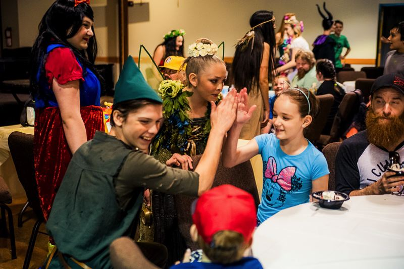 COURTESY PHOTO: EASTSIDE THEATER COMPANY - A couple of Eastside Theater Company actors high five during a break in last years inagural Character Cafe event, in which 30 actors studied up to portray iconic movie and animated characters from the past several decades.