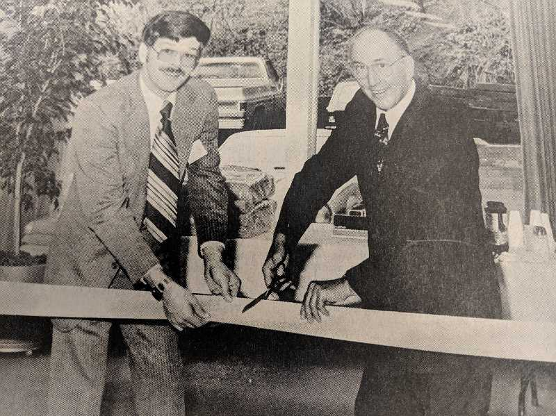 PMG ARCHIVE PHOTO - In 1979, a branch of the U.S. National Bank opened in Estacada. Branch manager Darrell Nastasi and local business owner Dave Horner are pictured during a ribbon cutting.