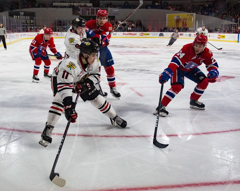 COURTESY: MEGAN CONNELLY, PORTLAND WINTERHAWKS - Robbie Fromm-Delorme of the Portland Winterhawks makes a play during Game 3 against the Spokane Chiefs on Tuesday at Memorial Coliseum.
