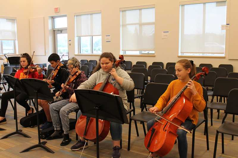 PMG PHOTO: HOLLY BARTHOLOMEW - Students in the Meridian Creek orchestra rehearse before their trip to Disneyland.