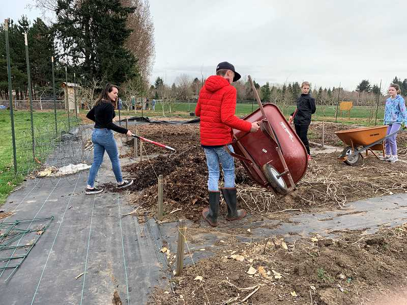 COURTESY PHOTO - Students prepare garden spaces at the CREST site for the entire district to use next fall.