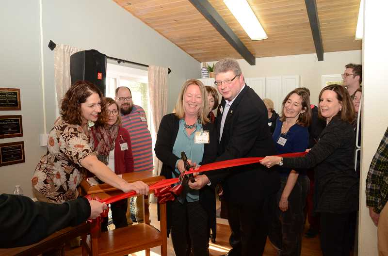 COURTESY PHOTOS - Family Promise Tualatin Valley Executive Director Rose Money cuts the ribbon to ceremoniously open the center. The center will serve homeless students and their families from Lake Oswego, Tigard-Tualatin and Sherwood school districts.
