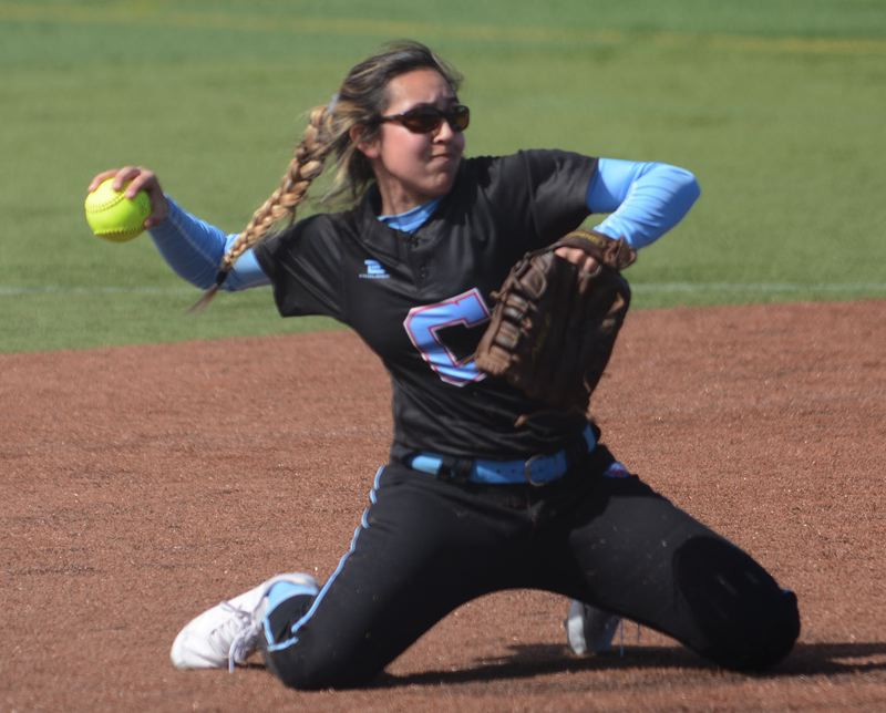 PMG PHOTO: DAVID BALL - Centennial shortstop Ashley Hawkins makes a throw from her knees after stopping the ball at shortstop in the first inning of Tuesdays 7-3 loss to McMinnville.