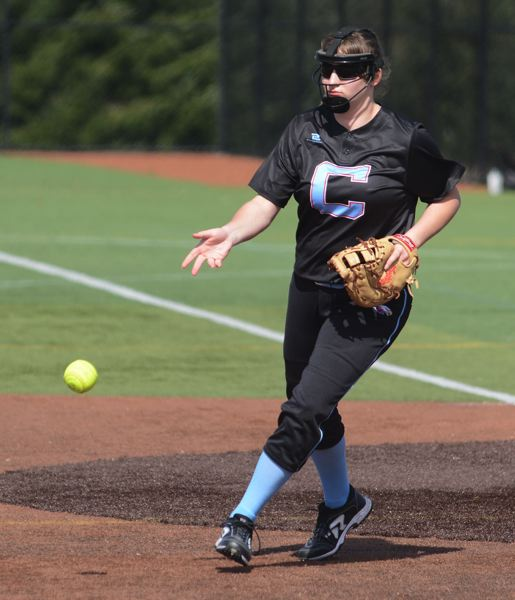 PMG PHOTO: DAVID BALL - Centennial rookie Alexis Henderson tosses the ball aside after coming up with a third out.
