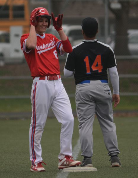 PMG PHOTO: DAVID BALL - Centennials Andrew Caron celebrates after hitting a three-run triple to the left-field fence in the first inning.