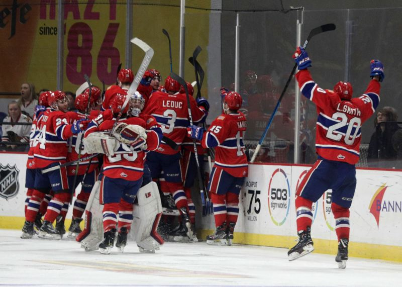 PMG PHOTO: JONATHAN HOUSE - The Spokane Chiefs celebrate after their winning goal in overtime Wednesday night at Memorial Coliseum. Spokane took a 3-1 lead in its best-of-seven WHL playoff series with the Portland Winterhawks.