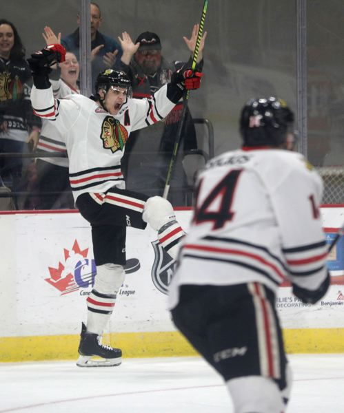 PMG PHOTO: JONATHAN HOUSE - Brendan De Jong (left) and Jake Gricius react after a Portland Winterhawks goal on Wednesday night at Memorial Coliseum. Spokane came back in the third period, though, and won in overtime, 4-3, to take a 3-1 lead in the best-of-seven series.