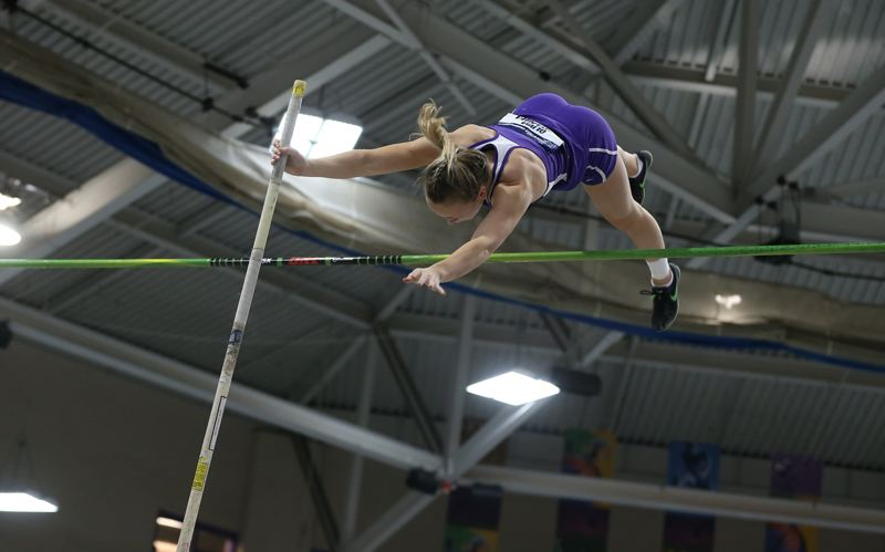 COURTESY PHOTO: D3PHOTOGRAPHY.COM - Linfield College's Olivia McDaniel clears the bar in the pole vault on her way to a national championship at Boston.