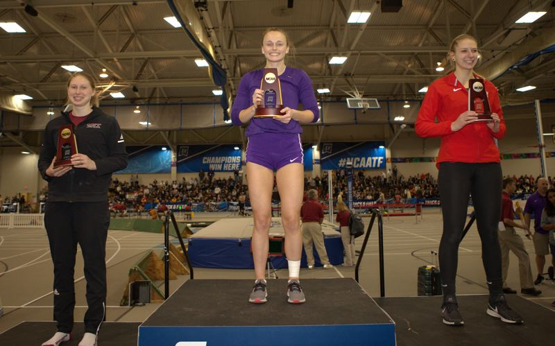 COURTESY PHOTO: D3PHOTOGRAPHY.COM - Olivia McDaniel (center), a Linfield College senior from Scappoose, is on the podium as NCAA Division III indoor pole vault champion.