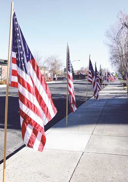 CENTRAL OREGONIAN - Members of the Band of Brothers will put up the Flags of Prineville this Saturday to honor veterans of the Vietnam era.