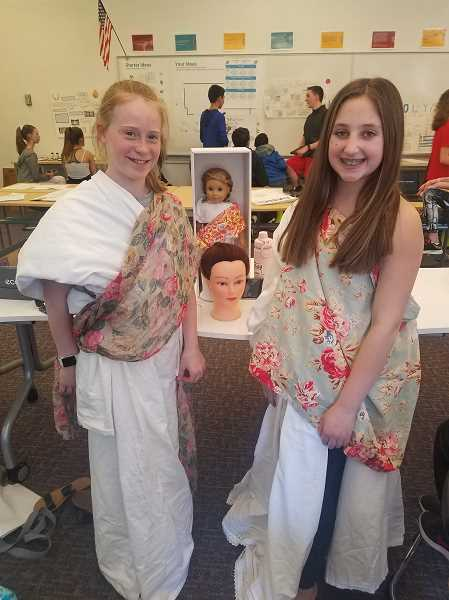 COURTESY PHOTO - Evadis Muir and Avery Betz teach about Roman fashion and hairstyles.