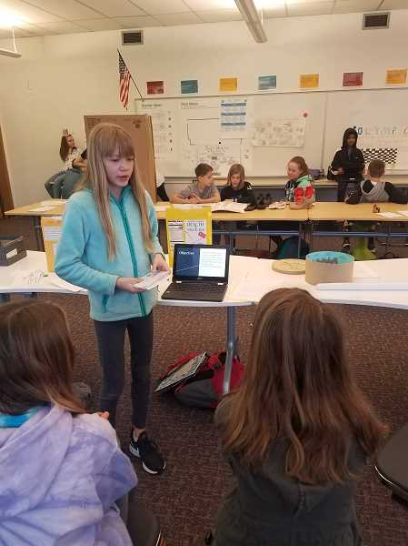 COURTESY PHOTO - Rachel Fleck teaches classmates about the history of flags, including their patterns and use of color.