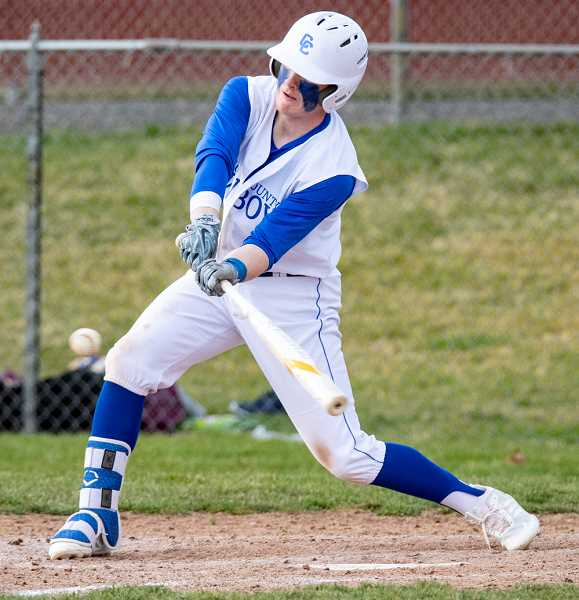 LON AUSTIN/CENTRAL OREGONIAN - Brody Connell lines a double into centerfield during the Cowboys' 4-2 victory over the Forest Grove Vikings Tuesday afternoon. With the win, the Cowboys improved to 4-3 on the year.