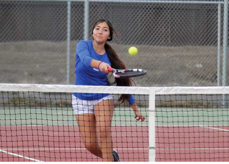 STEELE HAUGEN - Kelsey Olivera smashes the ball during her match against Ridgeview. The Buffs lost to the Ravens 6-2.