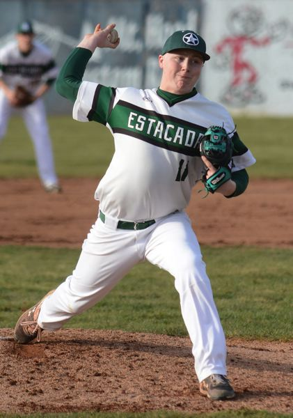PMG PHOTO: DAVID BALL - Estacada pitcher Daniel Hunt deals a throw to the plate during a win in the teams home opener.