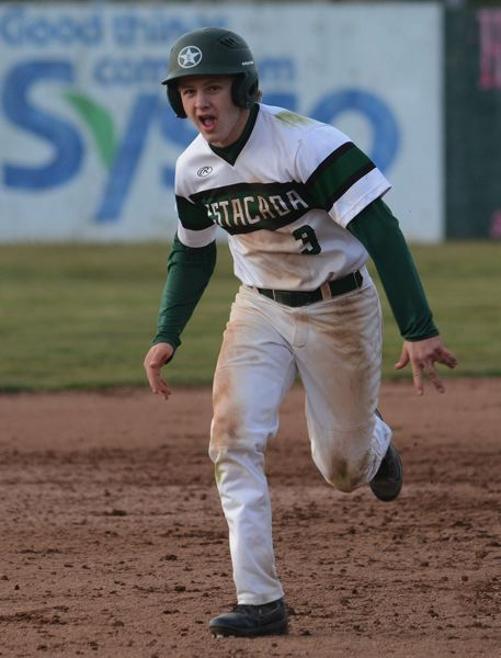 PMG PHOTO: DAVID BALL - Estacadas Kaden Settle sprints for third base.