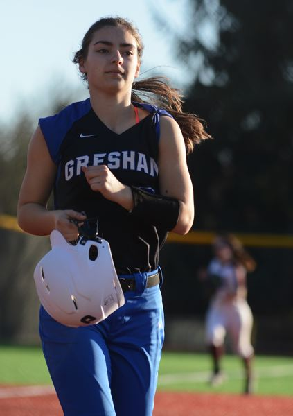 PMG PHOTO - Gresham pitcher Alise Olson trots toward the dugout after retiring the side in order during a 13-0 early-season at Milwaukie.