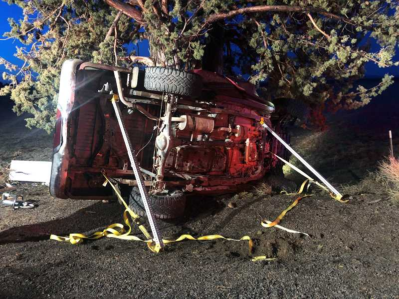 PHOTO COURTESY OF CROOK COUNTY SHERIFF'S OFFICE - The Toyota Tacoma lost control on Powell Butte Highway and slid into a tree crushing the cab.