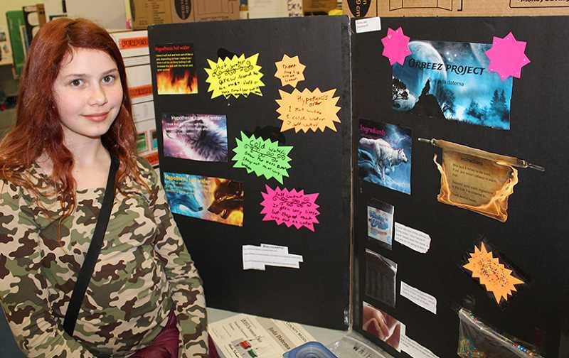 TONY AHERN/MADRAS PIONEER - Sixth-grader Jada Datema stands by her science fair project display last week at Jefferson County Middle School. Sixth-graders did an experiment of their choosing, and reported their findings on presentation boards. Seventh- and eighth-graders chose between creating a pinhole camera or a catapult.