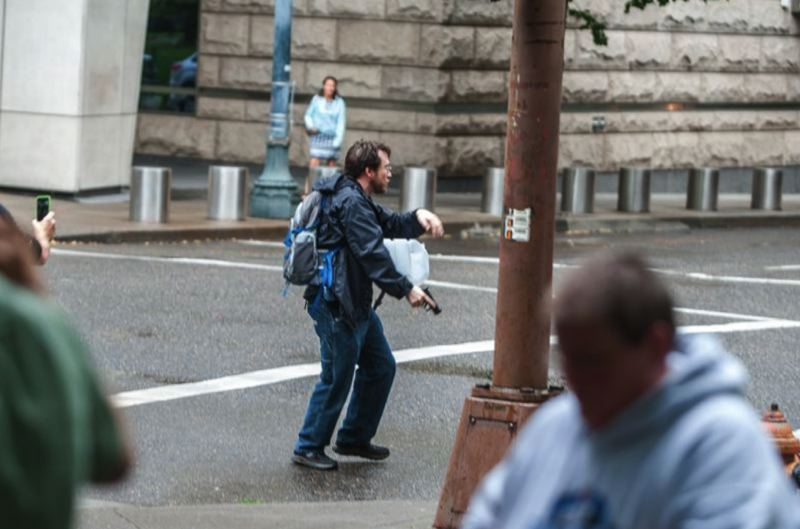 PMG FILE PHOTO - Michael Strickland holds a handgun during a downtown Portland protest near the Justice Center in July, 2016.