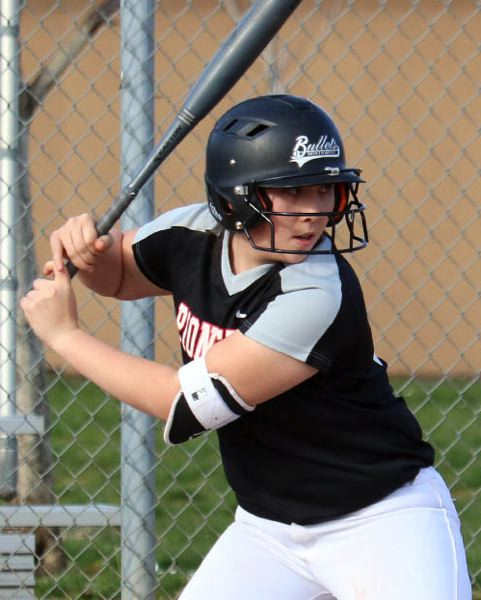 PMG PHOTO: JIM BESEDA - Oregon City's Isabelle Lewis went 3 for 3 with two doubles and two RBIs in a 12-5 win over Crater at Hood View Park.