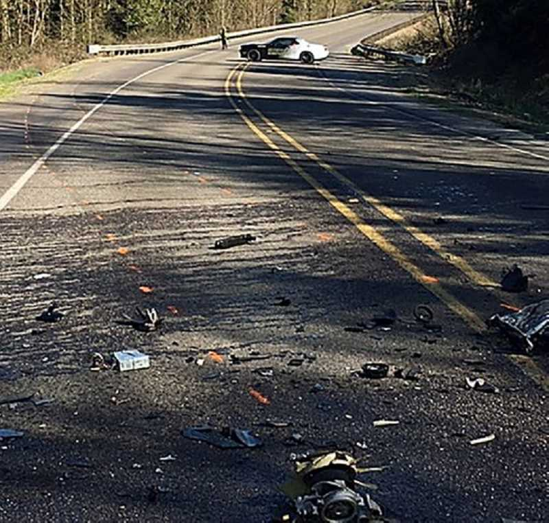PHOTO COURTESY OF MCSO - Debris from a two-vehicle crash that took the lives of three individuals is strewn­­ across McKay Road after the collision Saturday afternoon.