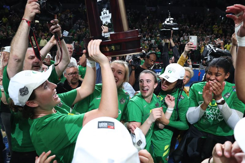 PMG PHOTO: JAIME VALDEZ - The Oregon Ducks celebrate after defeating Mississippi State 88-84 on Sunday at Moda Center to earn the school's first trip to the Final Four of womens basketball.