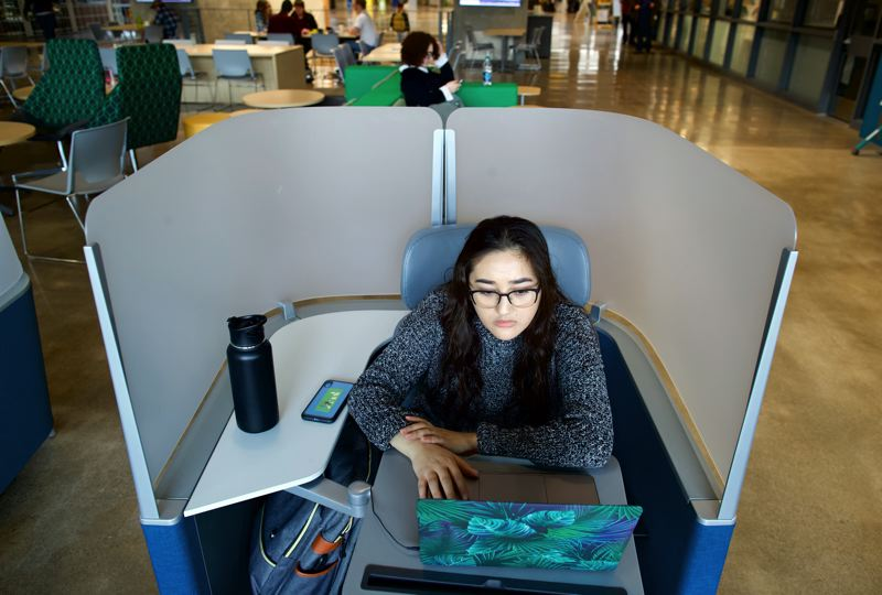 PMG PHOTO: JAIME VALDEZ - Anissa Rodriguez studies at the PCC Sylvania Campus on Monday, April 1. The community college has announced a series of cuts as the Legislature debates a reduced or hold-even budget for 2019-21.
