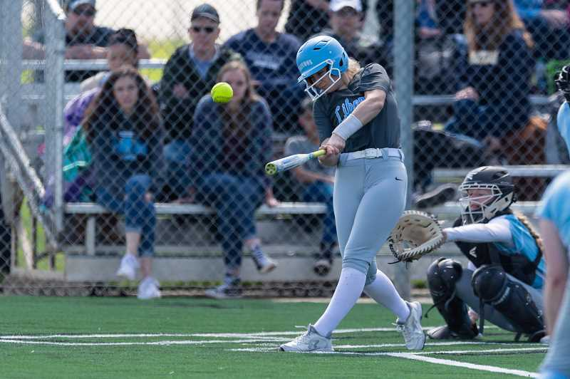 PMG PHOTO: CHRISTOPHER OERTELL - Liberty's Angelica Colbert takes a swing during the Falcons' game against Corvallis last Friday, March 29, at Glencoe High School.