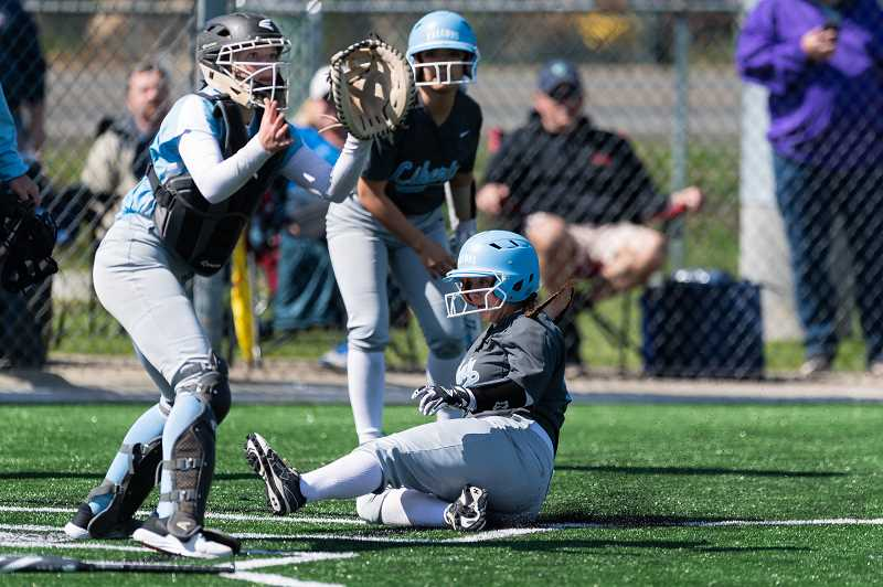 PMG PHOTO: CHRISTOPHER OERTELL - Liberty's Jillian Clement slides into home during the Falcons' game against Corvallis last Friday, March 29, at Glencoe High School.