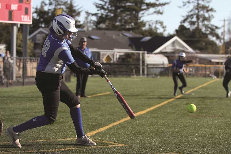 PMG PHOTO: PHIL HAWKINS - Woodburn sophomore Yami Rios connects on a base hit that drives in senior teammate Diana Ordaz.