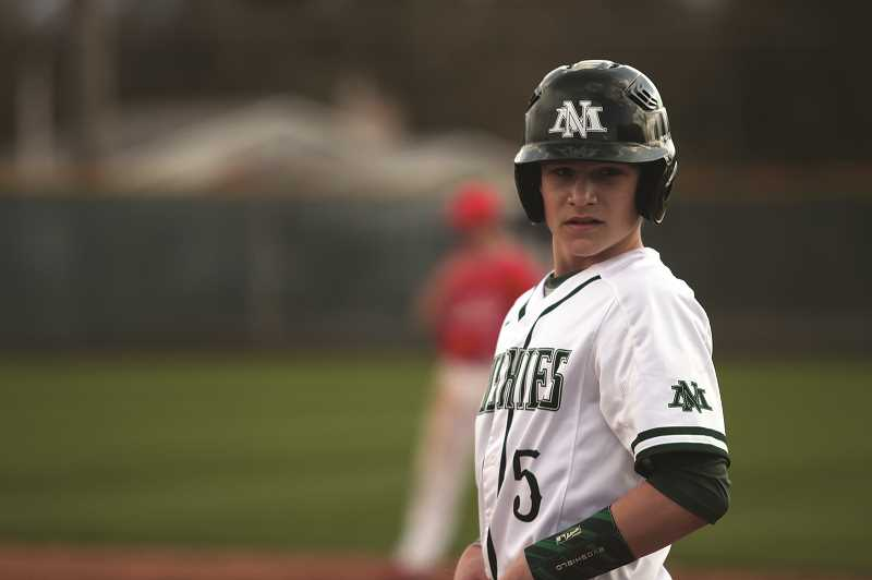 PMG PHOTO: PHIL HAWKINS - Freshman Evan Holman scored a team-best three runs in the Huskies 9-0 win over Philomath on Friday.