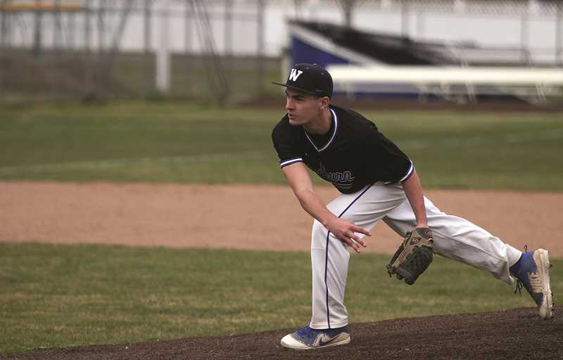 PMG FILE PHOTO: PHIL HAWKINS - Woodburn sophomore Jackson Pickett pitched the final four innings of the Bulldogs 4-2 win over Franklin on March 26.