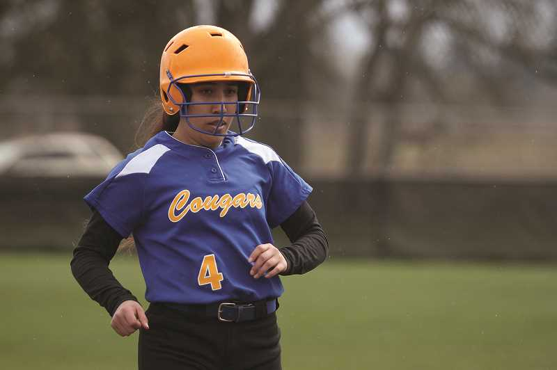 PMG PHOTO: PHIL HAWKINS - Gervais senior Jasmine Fernandez and the Cougars snapped a four-game losing streak with their 7-6 win over Blanchet Catholic on March 27.
