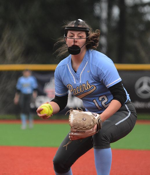 PMG PHOTO: DAVID BALL - Lakeridge rookie Holly Beeman scoops up a ground ball and moves toward first base to collect an out in the Pacers 7-0 shutout over David Douglas on Monday.