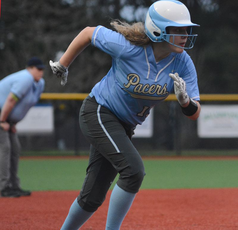 PMG PHOTO: DAVID BALL - Lakeridge sophomore Emily Paulson gets ready to pounce from third base.