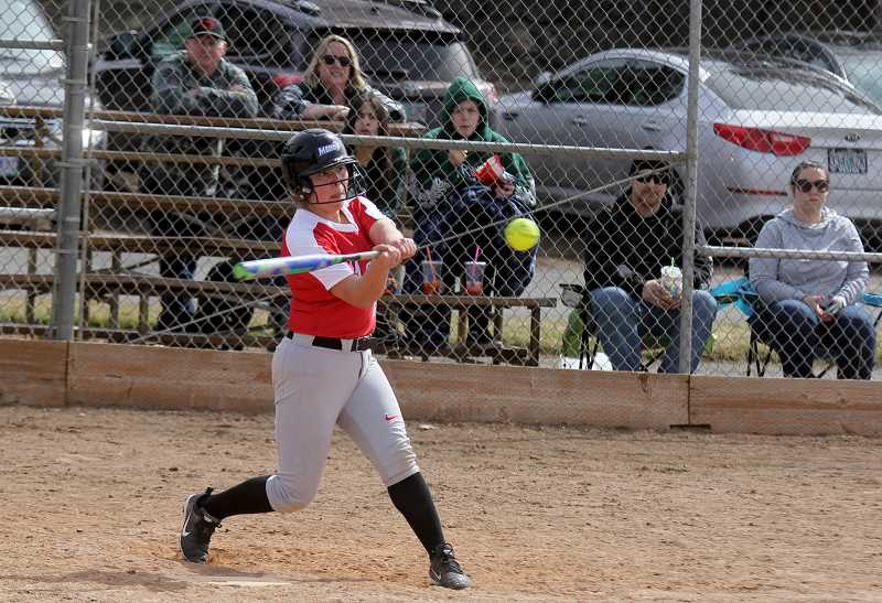 STEELE HAUGEN - Senior Mary Olney hit several doubles during the tournament, including two doubles in the late innings of the Redmond game.