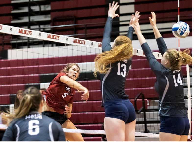 SUBMITTED PHOTO - 2015 Madras graduate and former volleyball player Shelby Mauritson, left, earned several collegiate conference honors and set school records at Central Washington University.