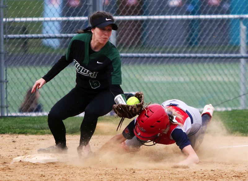 PMG PHOTO: DAN BROOD - Tigard senior shortstop Maddie Hoover (left) puts a tag on Westview sophomore Emma Antich on a stolen base attempt during Monday's game. Antich was called safe on the play.