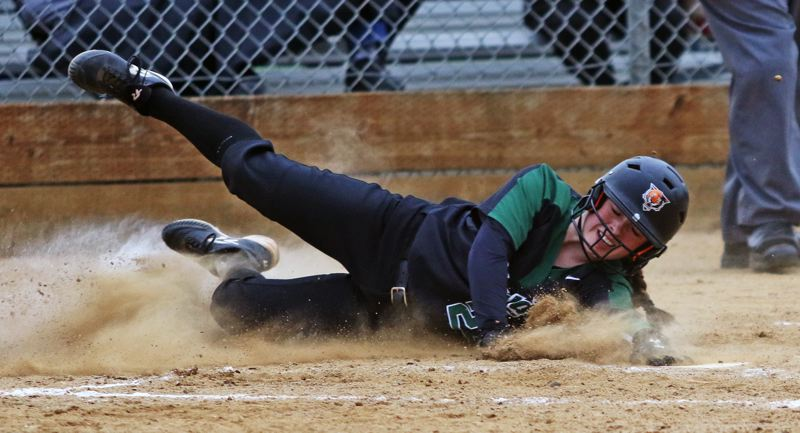 PMG PHOTO: DAN BROOD - Tigard High School junior Emily Paulson slides home safely for a fourth-inning run during the Tigers' game at Westview on Monday.