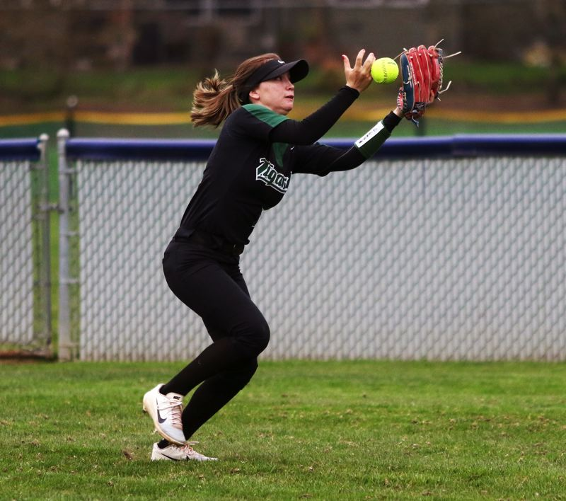 PMG PHOTO: DAN BROOD - Tigard High School junior center fielder Lexi Klum tries to run down a ball hit into the gap during the Tigers' game at Westview on Monday.