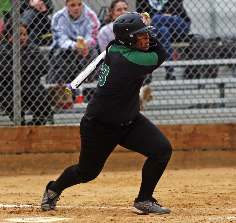 PMG PHOTO: DAN BROOD - Tigard High School freshman Kani Korok takes a swing during the Tigers' game at Westview on Monday.