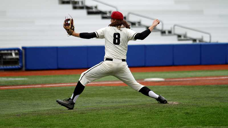 PMG PHOTO: WADE EVANSON - Glencoe senior Carter Larson throws a pitch during the Crimson Tide's game with Mountainside Wednesday, March 27, at Ron Tonkin Field.