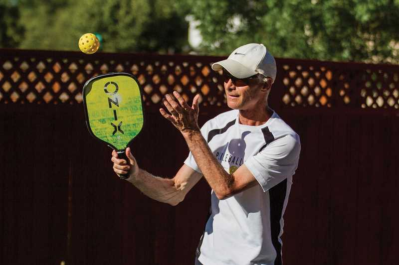 PMG FILE PHOTO - Steve Paranto competes in a game of pickleball on his court at his home in Hillsboro. The retired physical education teacher is passionate about growing the game.