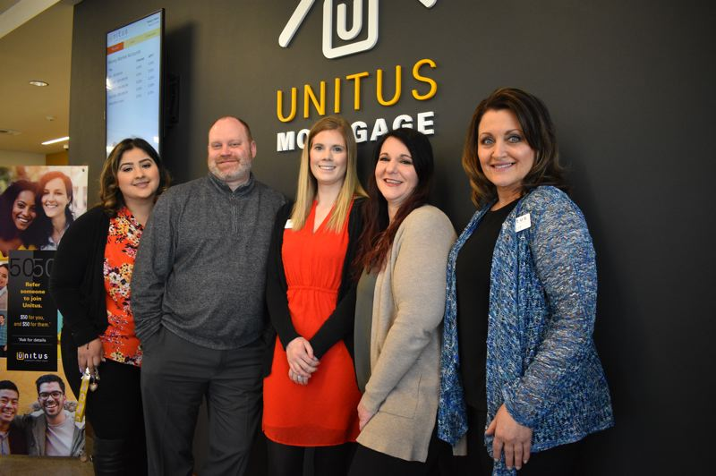 PMG PHOTO: SHANNON O. WELLS - From left, Itzel Figueroa, Boyd Carroll, Kelly Fink, Michelle Sumpter and Julie Fitzgerald comprise the core staff at the new Unitus branch at the Gresham Town Fair.