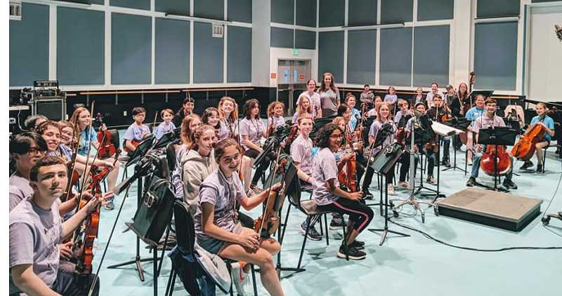 COURTESY PHOTO - The Meridian Creek and Rosemont Ridge orchestras record their performance of a classic Disney song at Disneyland Resort in California.