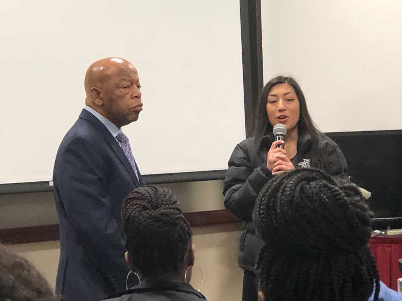 COURTESY PHOTO - Olivia Vigil, of Hillsboro, speaks with Rep. John Lewis, a congressman and active member of the civil rights movment