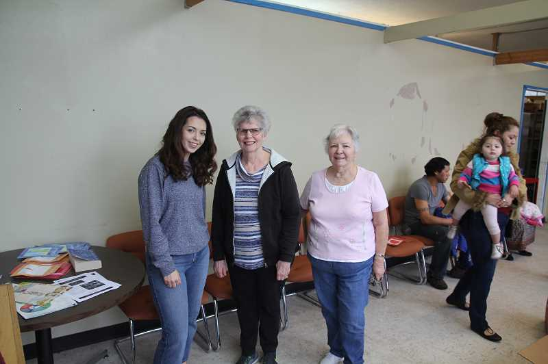PMG PHOTO: JUSTIN MUCH -  Woodburn Food Share Coordinator Gabby Pena, left, and food share helpers Sue and Fran are prepared to welcome Marion Polk Food Share workers on Tuesday, April 2, who stopped by for some painting tasks.